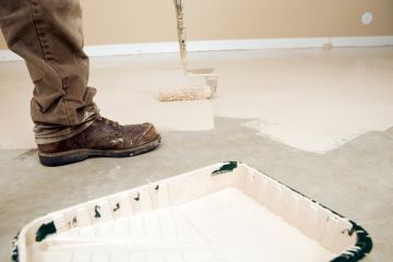 Painter painting garage floor in Emerald Hills
